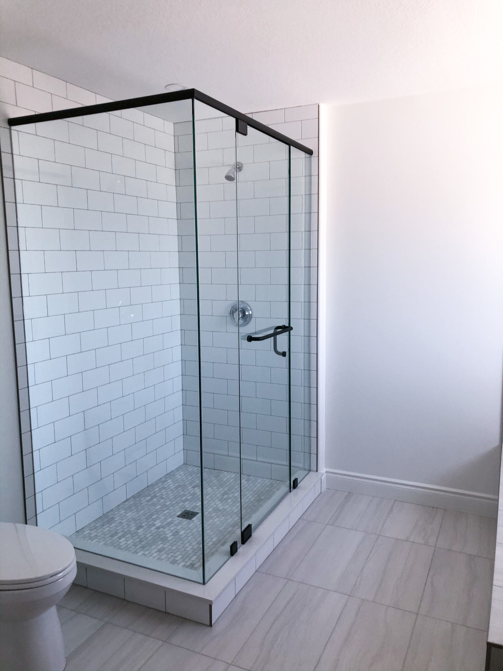 tile shower with clear doors