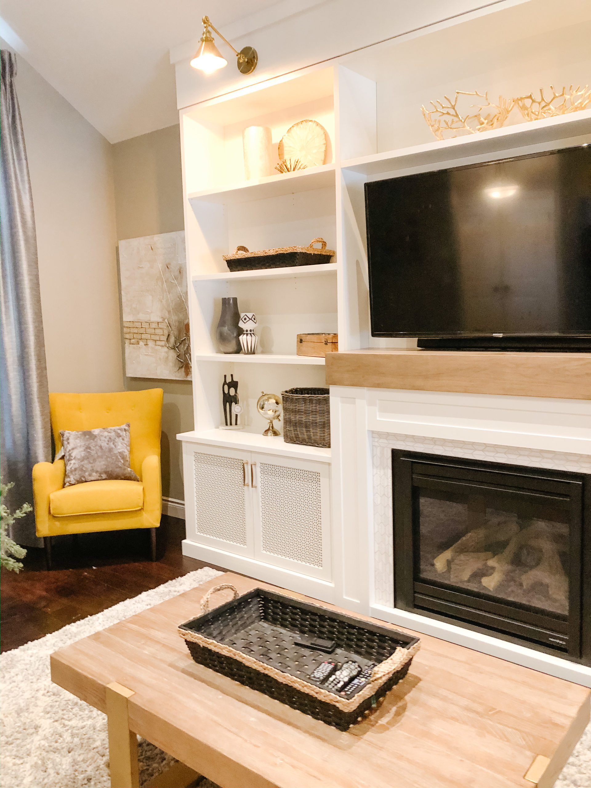 alternative view of living space with built in gas fireplace with additional seating