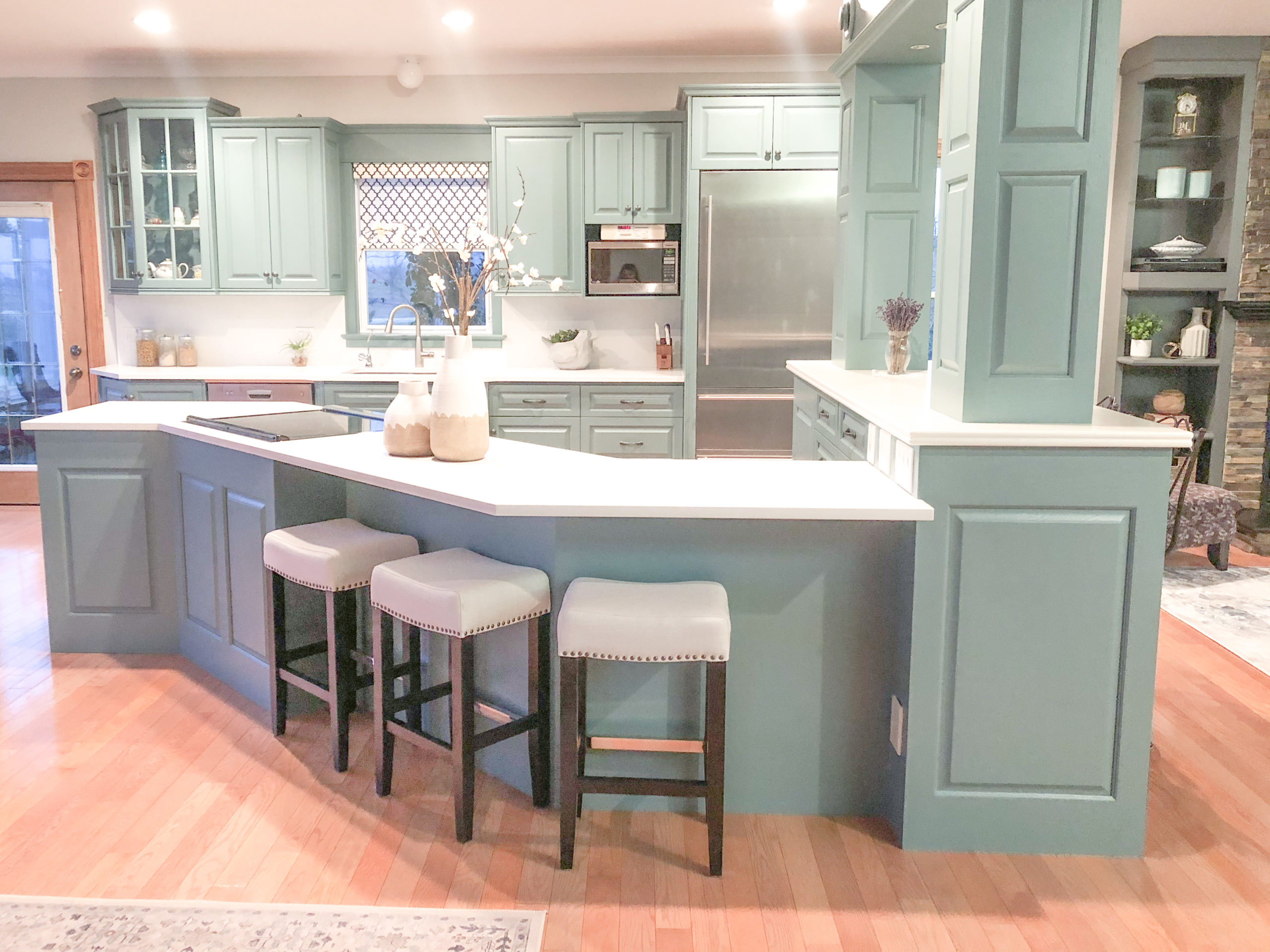 overview of whole kitchen featuring built in and painted cupboards